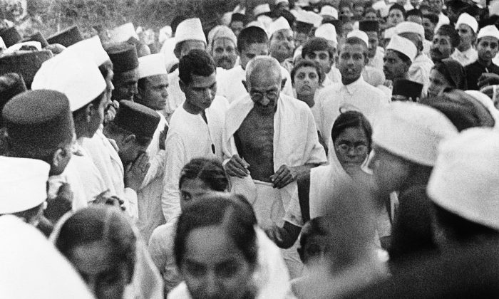 Mahatma Ghandi, who had many famous quotes and saying, surrounded by his followers during his Civil Disobedience Campaign around March 31, 1930. (AP Photo)