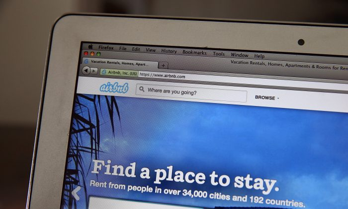 The Airbnb website is displayed on a laptop on April 21. (Justin Sullivan/Getty Images)