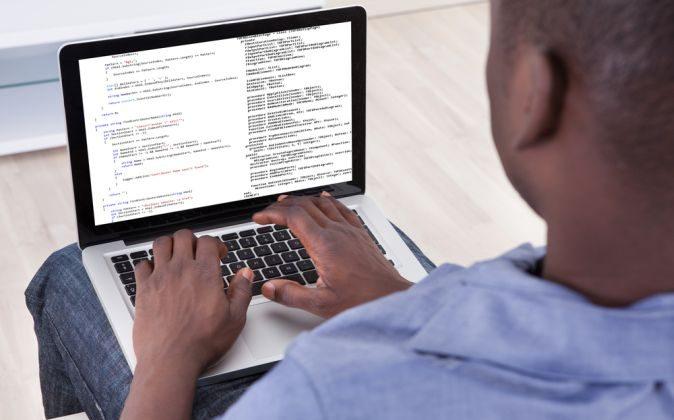 A software developer at work (Shutterstock*)