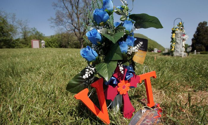 A carved-wood 'VT' rests on the grave of Virginia Tech University student Jarrett Lane in Narrows, Va., on May 13, 2007. Lane, a 22-year-old senior, was killed along with 26 other students and 5 University staff members during a shooting rampage the previous month. (Scott Olson/Getty Images)