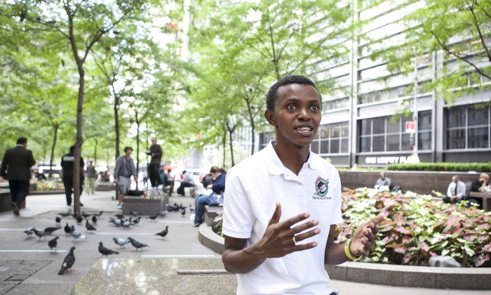 Alex Nsengimana, a Rwandan genocide survivor at Zuccotti Park in Lower Manhattan, New York on Sept. 18, 2014. (Samira Bouaou/Epoch Times)
