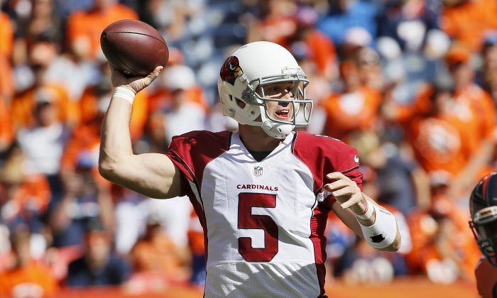 Arizona Cardinals quarterback Drew Stanton (5) throws against the Denver Broncos during the first half of an NFL football game, Sunday, Oct. 5, 2014, in Denver. (AP Photo/Jack Dempsey)