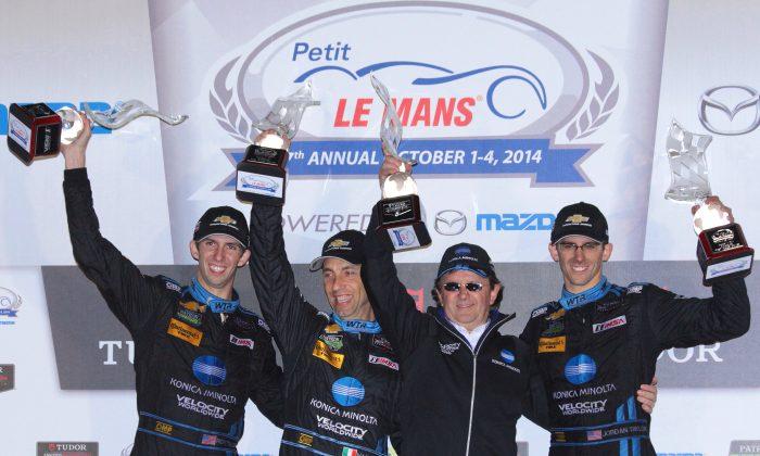 Ricky Taylor, Max Angelelli, Wayne Taylor, and Jordan Taylor, celebrate winning the 2014 Tudor United Sportscar Championship Petit Le Mans. (Chris Jasurek/Epoch Times)
