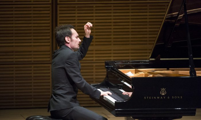 NTD Television's 2014 International Piano Competition gold winner Timur Mustakimov finishes the final note with a flourish at the Future Stars Recital at Carnegie Hall on Oct. 5, 2014. (Dai Bing/Epoch Times)