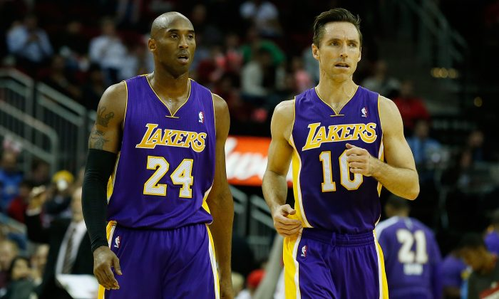 Kobe Bryant #24 and Steve Nash #10 of the Los Angeles Lakers walk across the court during their game against the Houston Rockets at Toyota Center on January 8, 2013 in Houston, Texas. (Scott Halleran/Getty Images)