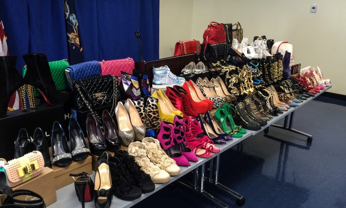 A selection of the stolen designer merchandise found in the Queens apartment of identity theft ringleader Tamara Williams displayed at the Manhattan District Attorney's press conference on Oct. 6, 2014 (Jonathan Zhou/Epoch Times)