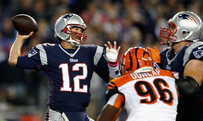 Tom Brady of the New England Patriots throws a pass against the Cincinnati Bengals at Gillette Stadium on Oct. 5, 2014 in Foxboro, Mass. (Jim Rogash/Getty Images)
