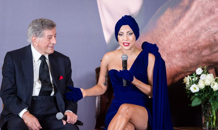 Lady Gaga, right, and Tony Bennett talk during a media event at the Brussels' city hall on Monday Sept. 22 , 2014. (AP Photo/Geert Vanden Wijngaert)