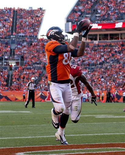 Denver Broncos tight end Julius Thomas pulls in a touchdown pass against the Arizona Cardinals during the second half of an NFL football game, Sunday, Oct. 5, 2014, in Denver. (AP Photo/David Zalubowski)