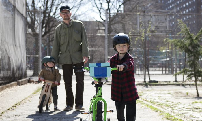 Brian Crowley takes his children Harrison,4,  and Ansel, 2, to the Luther Gulick Park on the Lower East Side in Manhattan, April 17. (Samira Bouaou/Epoch Times)