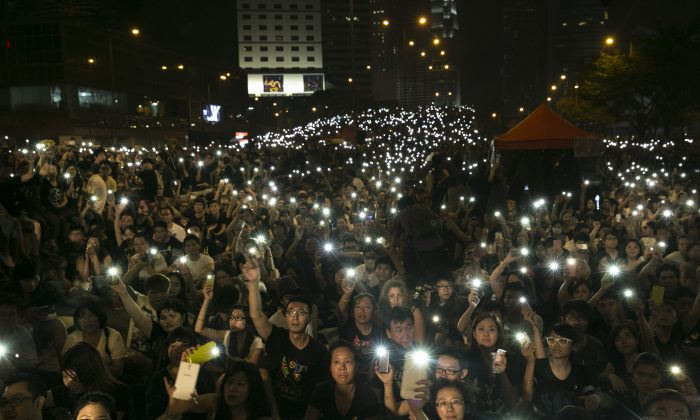 Tens of thousands of democracy protesters hold lights during speeches Oct. 4, 2014 in Hong Kong. On Oct. 10 negotations between students protesting for universal suffrage and the Hong Kong government are scheduled to begin. (Paula Bronstein/Getty Images)