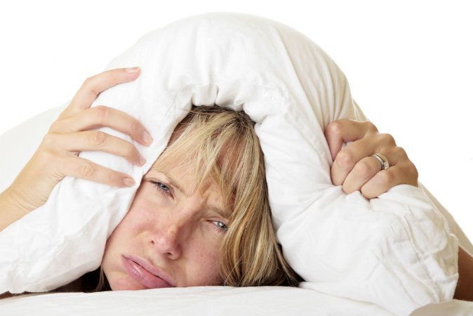Woman trying to sleep (Shutterstock*)