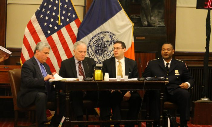 (L–R) Senior Deputy Commissioner Ari Wax, Commissioner Joseph Ponte, Deputy Commissioner for Strategic Planning and Programs Erik Berliner, Chief of Department William Clemons, at a City Council hearing in June 2014. Commissioner Ponte testified before the City Council on Wednesday to discuss reforms the department has taken to address the abuses against adolescent inmates at Rikers Island, reported in a recent federal investigation by the U.S. Department of Justice. (Brendon Fallon/Epoch Times)