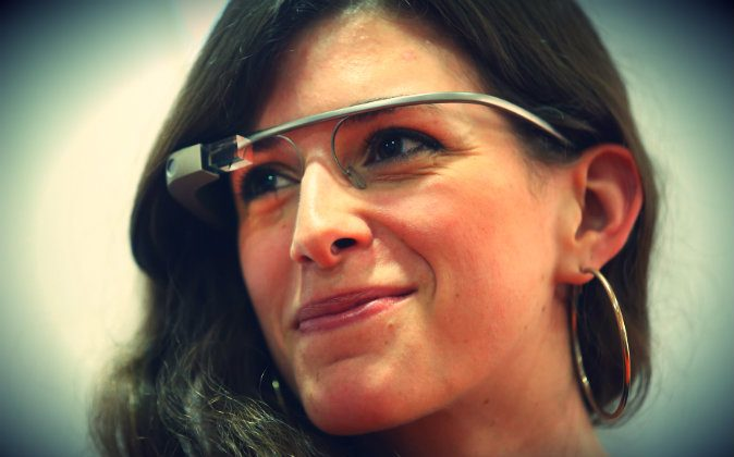 A young woman wears Google Glass at an unrelated book presentation and media event in Berlin, Germany on June 10, 2014. Google Glass, which films what the wearer sees and has a connection to the Internet, has caused controversy with privacy advocates. (Sean Gallup/Getty Images)