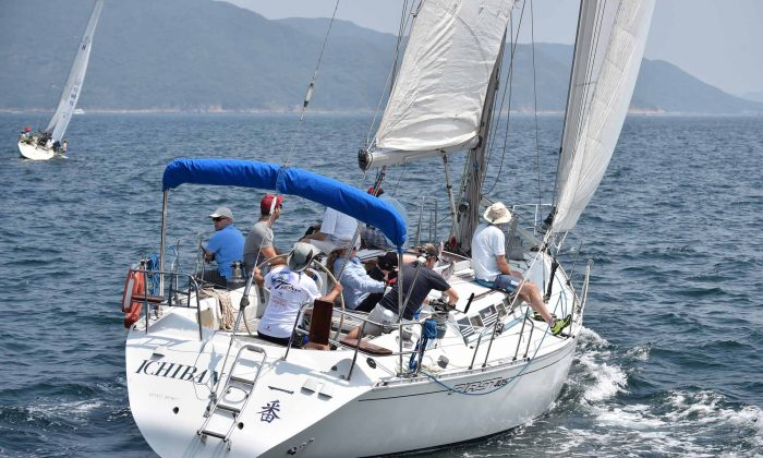 'Ichiban' with Geoff Tayler at the Helm sailing upwind during Race-1 of the Helmsman races at Port Shelter on Sunday Oct 5, 2014. Ichiban finished 3rd in each of the two races to secure the overall 3rd place position. (Bill Cox/Epoch Times)