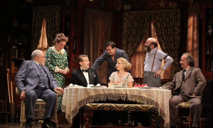 "(L–R) James Earl Jones, Kristine Nielsen, Fran Kranz, Reg Rogers, Annaleigh Ashford, Patrick Kerr, and Mark Linn-Baker play the loveable eccentrics in ""You Can't Take It With You."" (Joan Marcus)"