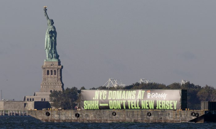 The GoDaddy barge travels up the Hudson River to promote the new .nyc internet domains, Wednesday, Oct. 8, 2014, in New York. (John Minchillo/AP Images for GoDaddy)