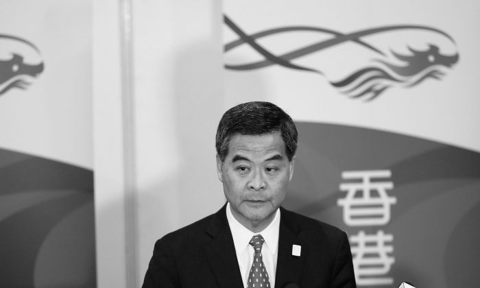 Hong Kong Chief Executive Leung Chun-ying speaks to Hong Kong journalists at a press conference during the APEC Summit on Oct. 6, 2013 in Nusa Dua, Indonesia. The leak of confidential financial documents implicating Leung in possibly improper payments of $6.5 million was likely arranged by authorities in Beijing. (Putu Sayoga/Getty Images)