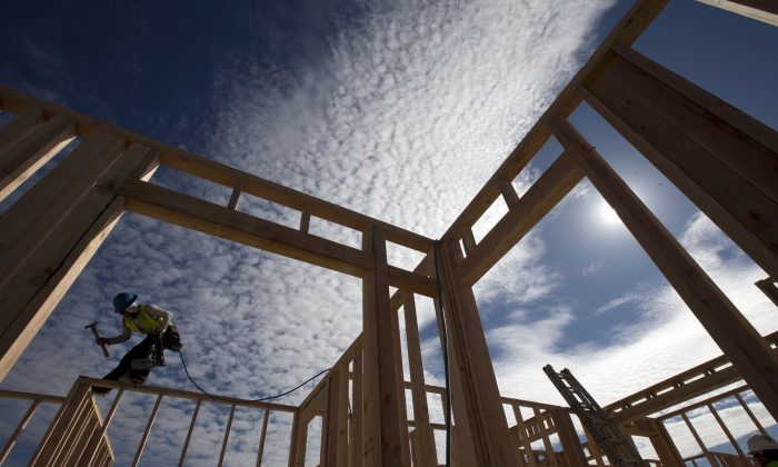 Construction worker Elabert Salazar works on a house frame for a new home Friday, Nov. 16, 2012, in Chula Vista, Calif. Employers added 45,800 new jobs in California in October, according to the state Employment Development Department. (AP Photo/Gregory Bull)