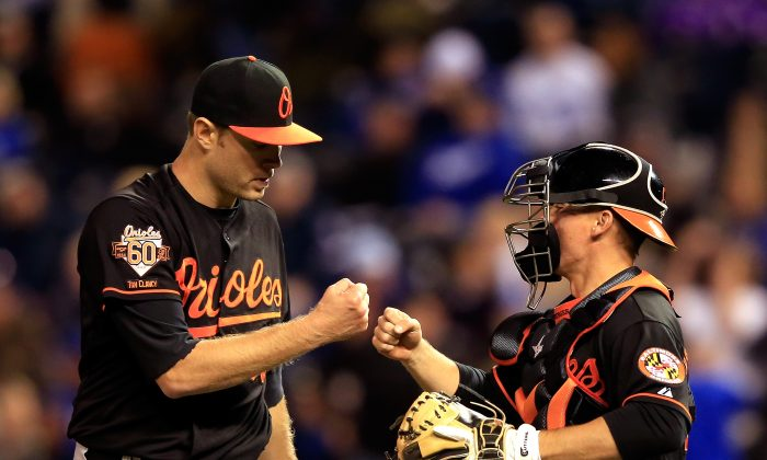 The Orioles, including starting pitcher Chris Tillman (L) and catcher Steve Clevenger, will be looking to slow down the Royals on the base paths in the ALCS. (Jamie Squire/Getty Images)