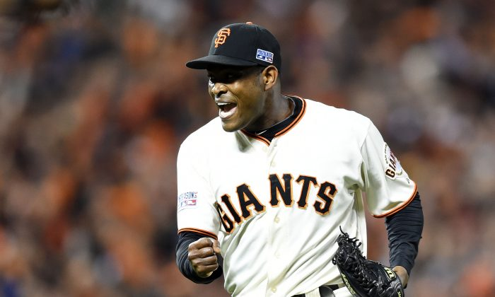 Giants closer Santiago Casilla saved two of San Francisco's three ALDS wins while throwing three scoreless innings. (Thearon W. Henderson/Getty Images)