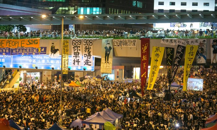 "Thousands of pro-democratic protesters fill what they are now calling ""Umbrella Square,"" in the Central District of Hong Kong, where all of the Government officers are on Oct. 10, 2014. Thousands came in support of the protest after the Government canceled today's talks with the organizers of the movement. (Benjamin Chasteen/Epoch Times)"
