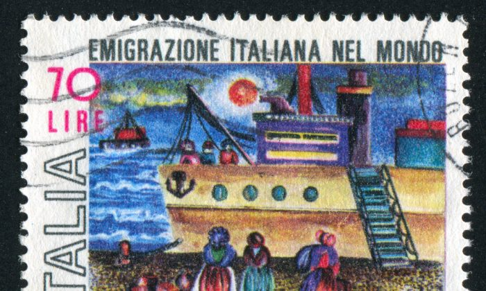 A stamp celebrating Italian emigration of the past century. The migration continues unabated, thanks to the economic downturn.  'Italian Emigration in the World' says the stamp.(Shutterstock*)