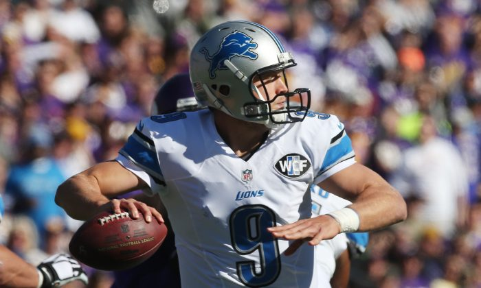 Detroit Lions quarterback Matthew Stafford looks downfield during the first half of an NFL football game against the Minnesota Vikings, Sunday, Oct. 12, 2014, in Minneapolis. (AP Photo/Jim Mone)