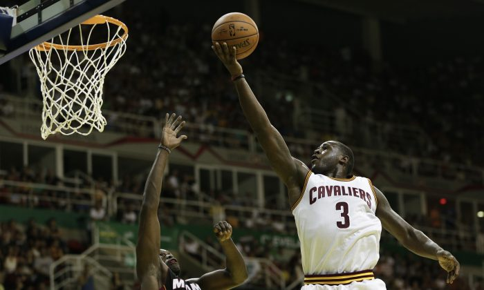 Cleveland Cavaliers' Dion Waiters shoots over Miami Heat's Luol Deng at a NBA preseason basketball game that's part of the NBA Global Games in Rio de Janeiro, Brazil, Saturday, Oct. 11, 2014. (AP Photo/Felipe Dana)