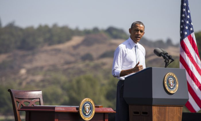 President Barack Obama announced nearly 347,000 acres within the San Gabriel Mountains northeast of Los Angeles a national monument at the Frank G. Bonelli Regional Park in San Dimas, Calif. on Oct. 10, 2014. (Evan Vucci/AP Photo)