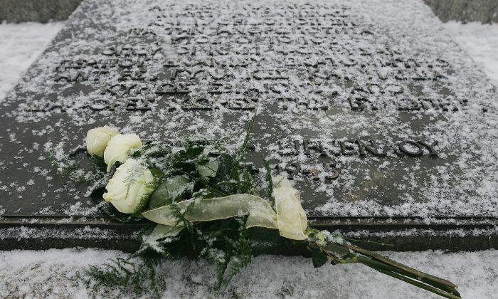 A bouquet of flowers lies on the Holocaust memorial at Auschwitz, Poland. (Julian Herbert/Getty Images)