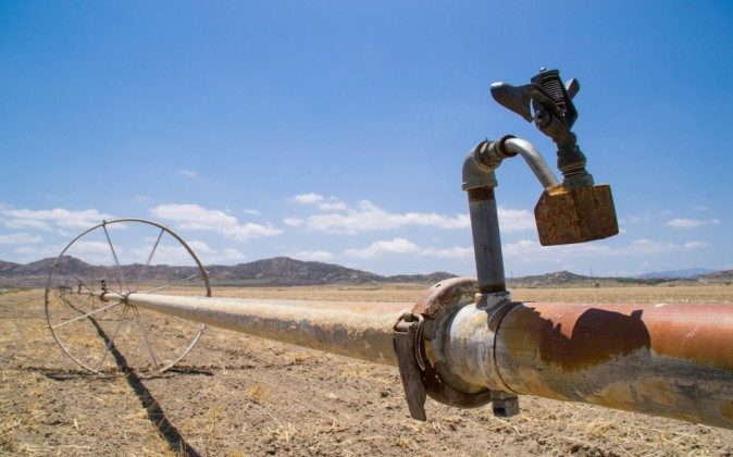 The water irrigation pipes in the dry Southern California farmland. (Shutterstock*)