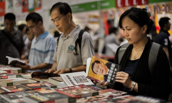 Visitors browse Chinese political books at the Hong Kong Book Fair in Hong Kong on July 18, 2012. (Philippe Lopez/AFP/GettyImages)