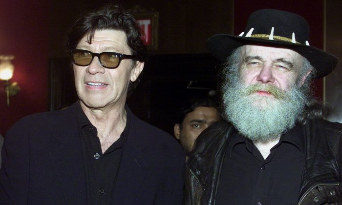 "Robbie Robertson and Garth Hudson, former members of The Band, arrive at the New York premiere for ""The Last Waltz"" on April 10, 2002. The film, directed by Martin Scorsese, features the last concert by The Band at the Winterland Ballroom in San Francisco in 1976. (REUTERS/Jeff Christensen)"