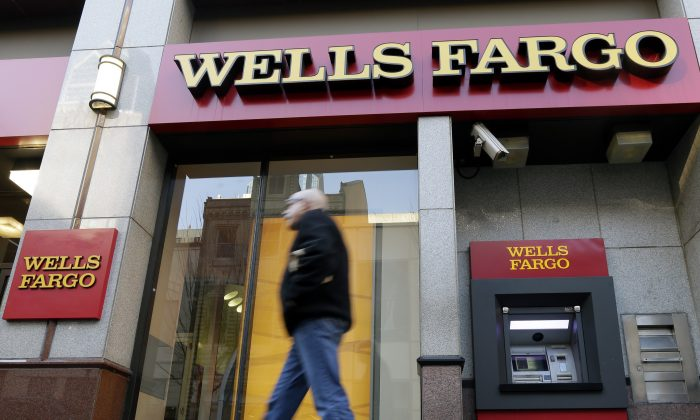 On Thanksgiving 2014, banks like Wells Fargo, Chase, Citibank, U.S. Bank, BB&T, Regions Bank, Suntrust Bank, TD Bank, Santander Bank, M&T Bank, KeyBank, BBVA Compass, and Bank of the West are closed. FILE - In this Wednesday, Dec. 19, 2012, file photo, a man walks past a Wells Fargo branch in Philadelphia. Wells Fargo and Chase, two of America's biggest retail banks, are quietly taking some callers' voiceprints to fight fraud, an Associated Press investigation has found. (AP Photo/Matt Rourke, File)
