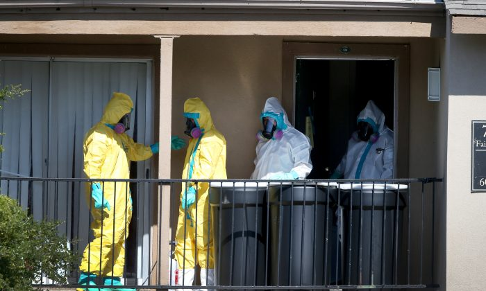 embers of the Cleaning Guys Haz Mat clean up company sanitize the apartment (top R) where Ebola patient Thomas Eric Duncan was staying before being admitted to a hospital on October 5, 2014 in Dallas, Texas. (Joe Raedle/Getty Images)