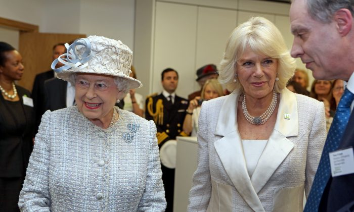 The rumors about Queen Elizabeth II, left, having Alzheimer's may have been started by Camilla, Duchess of Cornwall, members of the public believe. (WPA Pool/Getty Images)