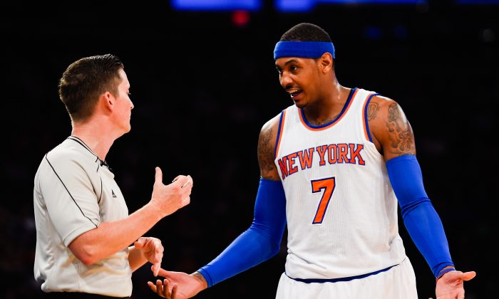 Carmelo Anthony #7 of the New York Knicks speaks to an official during a game against the Toronto Raptors at Madison Square Garden on October 13, 2014 in New York City. (Alex Goodlett/Getty Images)