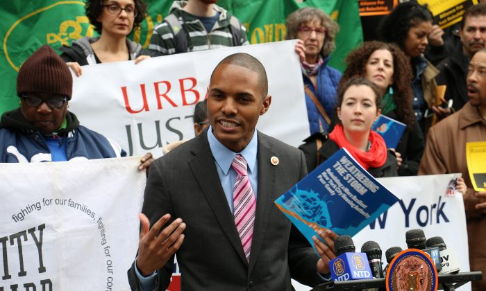 New York City council member Ritchie Torres joins public housing residents gathered at City Hall to call for more funding to help repair damaged buildings, in March 2014. On Tuesday, Oct. 14, 2014, Torres criticized the city's housing authority for its strict eligibility requirements for domestic violence victims to apply for priority housing. (Allen Xie/Epoch Times)