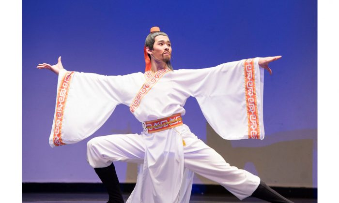 "Danny Li, 17, gold winner of the junior male division performing ""Touring the Sacred Country"" at BMCC Tribeca Performing Arts Center in New York on Oct. 12. (Dai Bing/Epoch Times)"