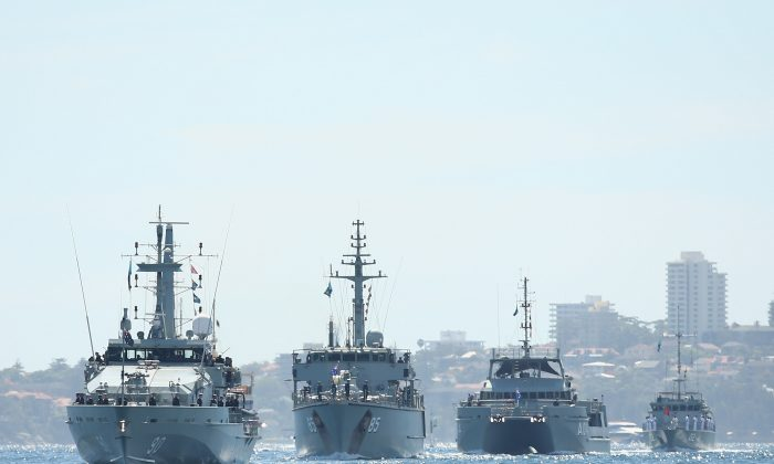HMAS Broome (II) leads HMAS Gascoyne (II), HMAS Benalla (II) and other Australian Navy ships during the International Fleet Review on October 5, 2013 in Sydney, Australia. Over 50 ships participate in the International Fleet Review at Sydney Harbour. (Cameron Spencer/Getty Images)