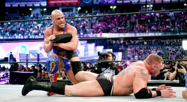 Kurt Angle takes on Brock Lesnar in a file photo; he could return to the WWE full-time. (WWE)