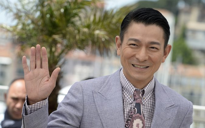 Chinese actor Andy Lau waves on May 20, 2013 while posing during a photocall for the film 'Blind Detective' presented Out of Competition at the 66th edition of the Cannes Film Festival in Cannes. Cannes, one of the world's top film festivals, opened on May 15 and will climax on May 26 with awards selected by a jury headed this year by Hollywood legend Steven Spielberg. (Anne-Christine Pouiloulat/AFP/Getty Images)