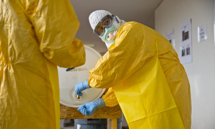 A licensed clinician sanitizes his hands after a simulated training session  in Anniston, Ala. on Oct. 6, 2014. The Centers for Disease Control and Prevention (CDC) has developed an introductory training course for licensed clinicians. According to the CDC, the course is to ensure that clinicians intending to provide medical care to patients with Ebola have sufficient knowledge of the disease. (AP Photo/Brynn Anderson)