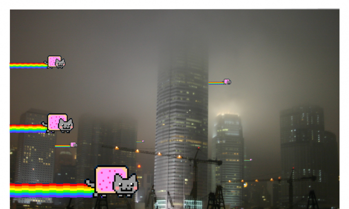 In a graphic from hacker group Anonymous, Nyan Cats from a popular meme are shown flying into China. On Oct. 15, Anonymous declared cyberwar on the Chinese regime and announced a new series of attacks. (Anonymous)
