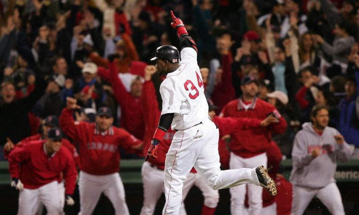 David Ortiz #34 celebrates after hitting the game winning two-run home run against the New York Yankees in the twelfth inning during game four of the American League Championship Series on October 17, 2004 at Fenway Park in Boston, Massachusetts. (Jed Jacobsohn/Getty Images)