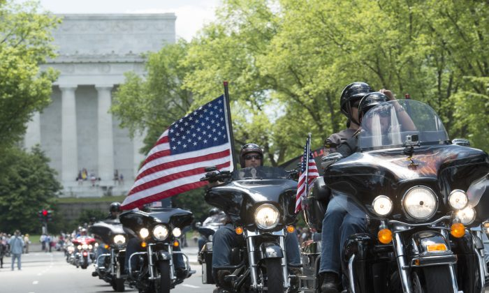 Riders participate in the the annual Rolling Thunder 'Ride for Freedom' motorcycle rally, with the Lincoln Memorial in the background, in Washington, Sunday, May 25, 2014. (AP Photo/Molly Riley)