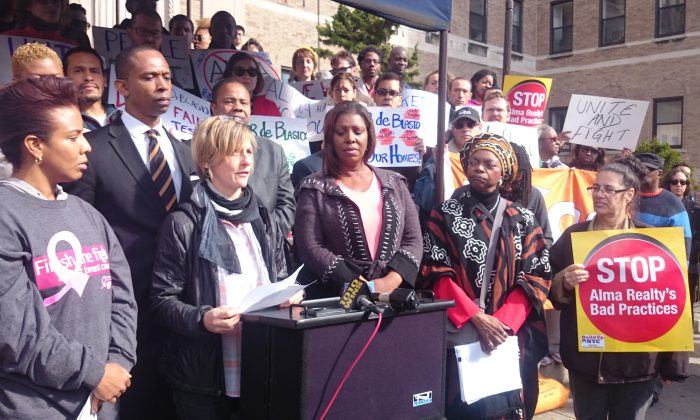Alethea Adsitt, a tenant at 545 Prospect Place, and tenants from other Alma Realty buildings on the block joined elected officials in a rally for affordable housing, in Brooklyn, Oct. 19, 2014. (Catherine Yang/Epoch Times)