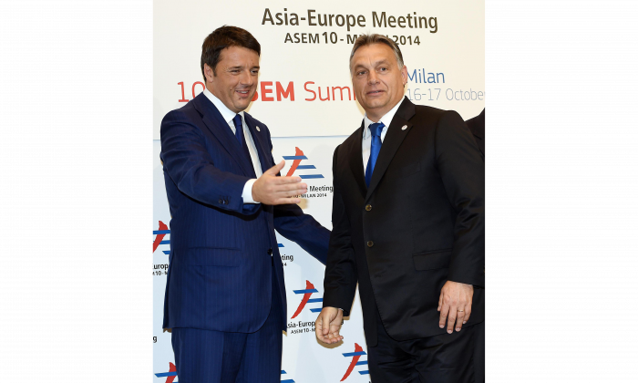Hungarian Prime Minister Viktor Orban (R) is welcomed by Italian Prime Minister Matteo Renzi before the 10th Asia-Europe Meeting (ASEM) in Milan on Oct. 16, 2014. (Daniel Dal Zennaro/AFP/Getty Images)