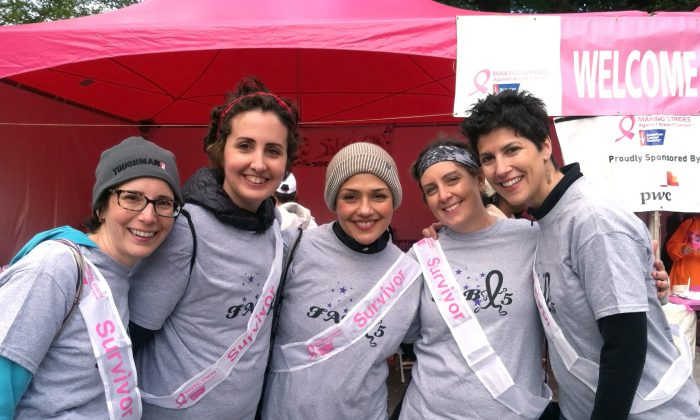 Barbara Trencher (R), 39, poses with her friends at the 21st annual Making Strides Against Breast Cancer walk in Central Park on Sunday, Oct. 19, 2014. Trencher met her breast cancer survivor-friends while in the waiting room at the Memorial Sloan-Kettering Cancer Center, and they have supported each other through the highs and lows of their lives ever since. (Annie Wu/Epoch Times)